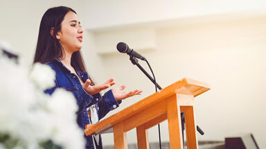 woman giving commemorative speech