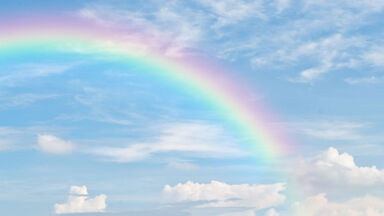Rainbow in a blue sky as examples of symbolism in poetry