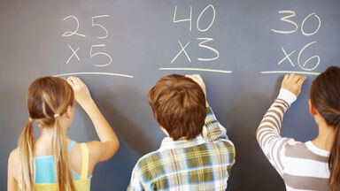 students practice multiplication problems