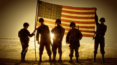 american soldiers holding U.S. flag