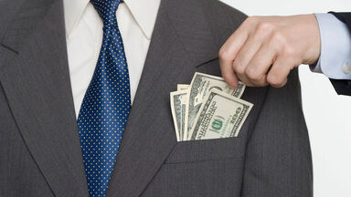 Man taking money from another's pocket as example of unethical behavior