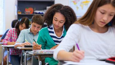 students at desk classroom