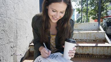 Woman doing Crossword