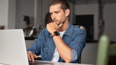 man writing resignation letter