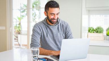 man writing letter of interest