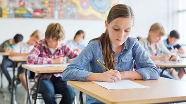 students in classroom adverb quiz practice