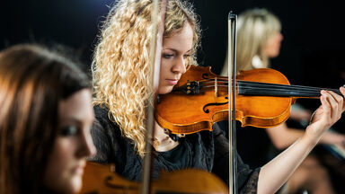 Woman playing violin classical music