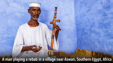 Man playing rebab instrument Egypt