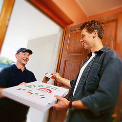 Man paying pizza delivery man as payment terms examples