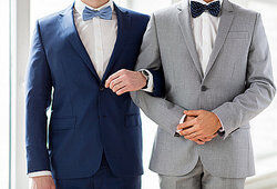Two men wearing suits as red herring examples