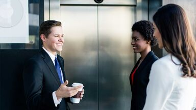 business professional giving elevator pitch