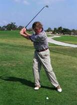 Photo showing backweighted sway at the top of swing