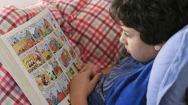 boy reading a graphic novel