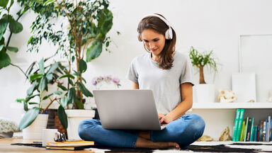 woman writer with headphones on