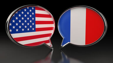 USA and France flags with Speech Bubbles