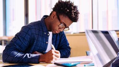 young man doing creative writing