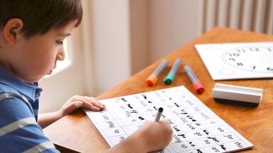 boy practicing spelling