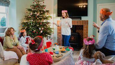family playing Christmas charades game