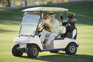 golfers riding in golf cart