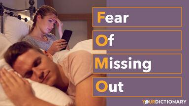 Woman Using Mobile Phone Man Sleeps FOMO Abbreviation Explained