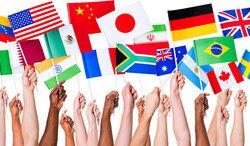 hands holding international flags