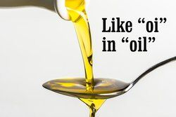 Olive oil poured on a spoon