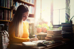 woman working on research paper