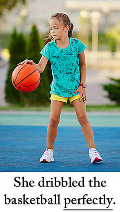 She dribbled the basketball perfectly.