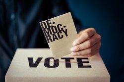 Hand Holding Voting Ballot