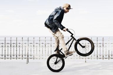 Boy riding BMX bicycle