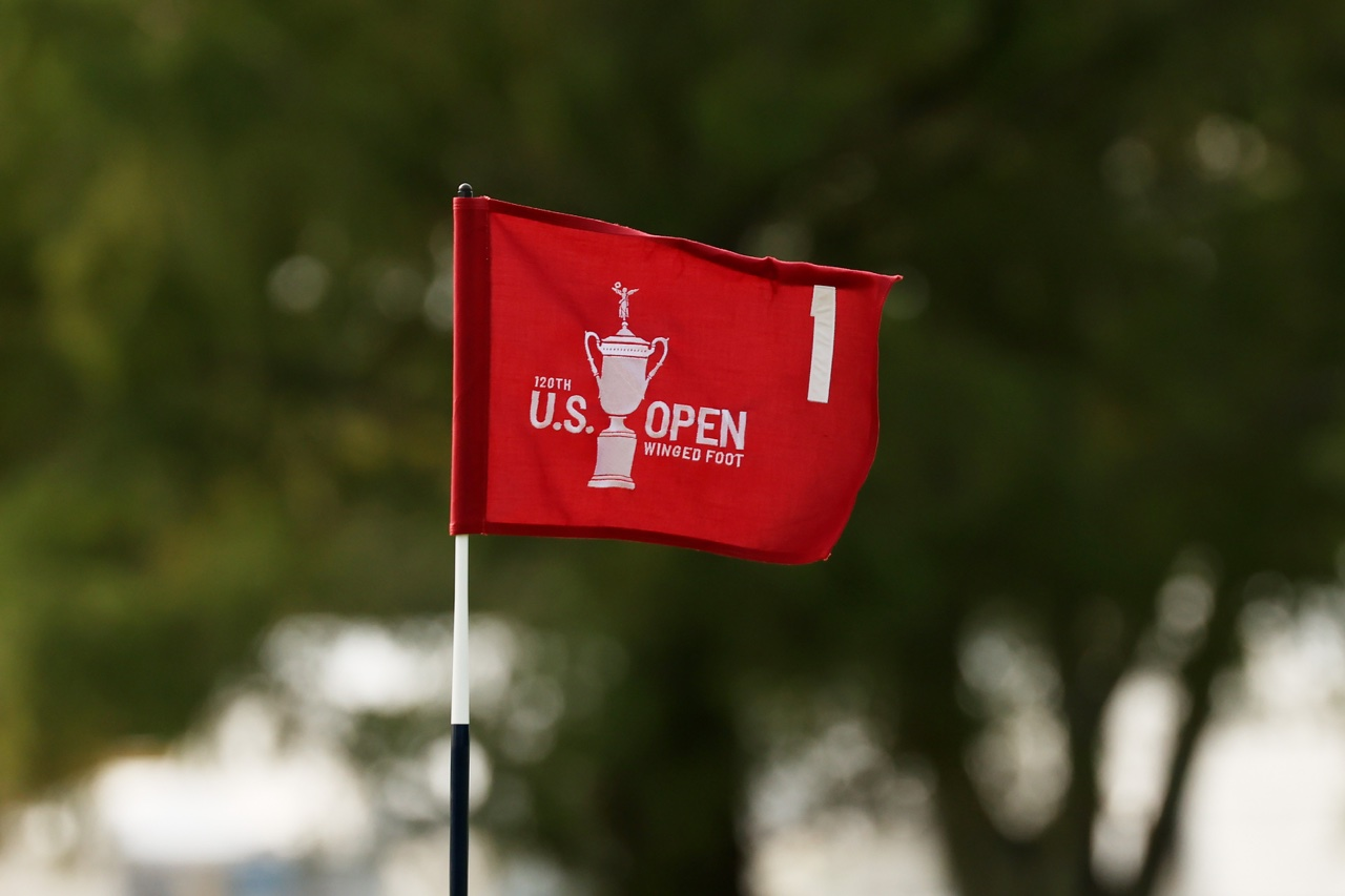 U.S. Open flag blows on a flagstick