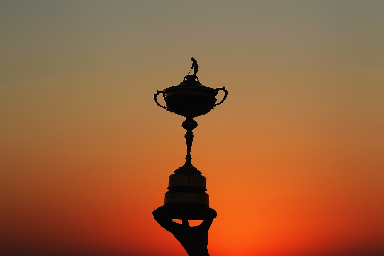 The Ryder Cup trophy against a sunset