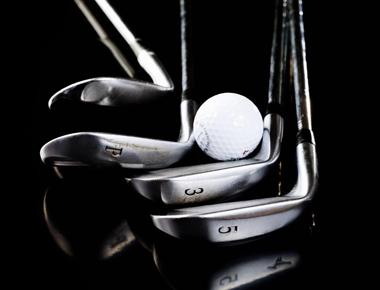 golf clubs and a golf ball