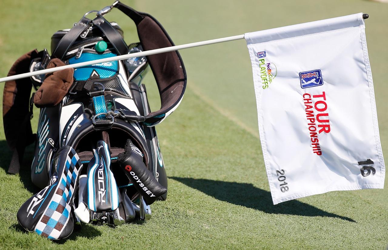 A Tour Championship flag rests on a bag