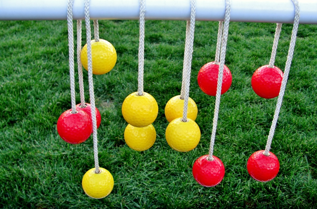 Bolas hang on a ladder golf rung