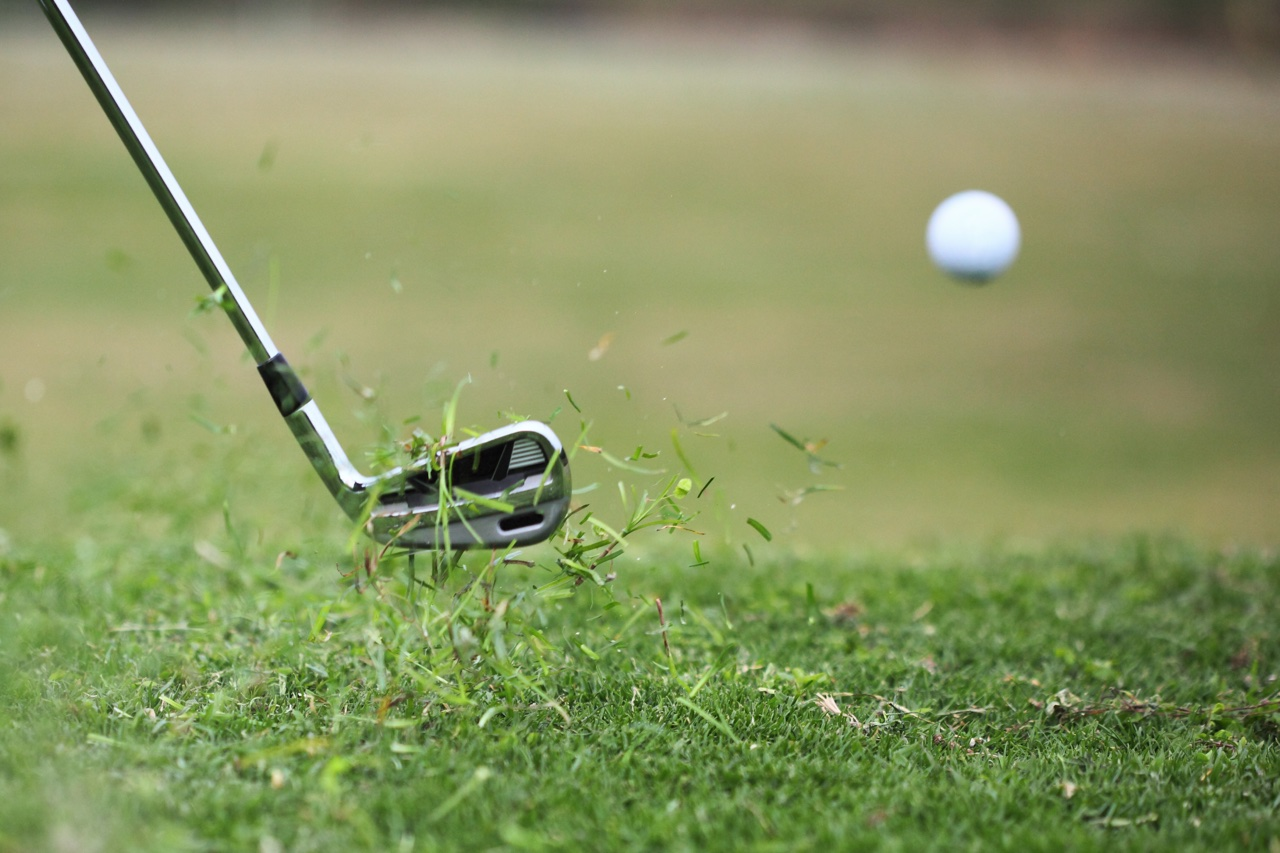 a golf shot just after impact