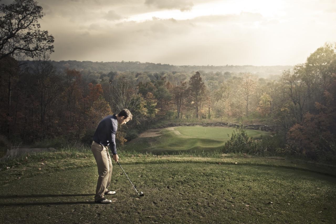 golfer prepares to hit a shot