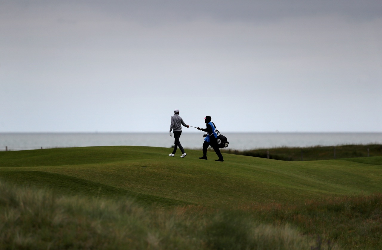 Golfer and caddie on the course