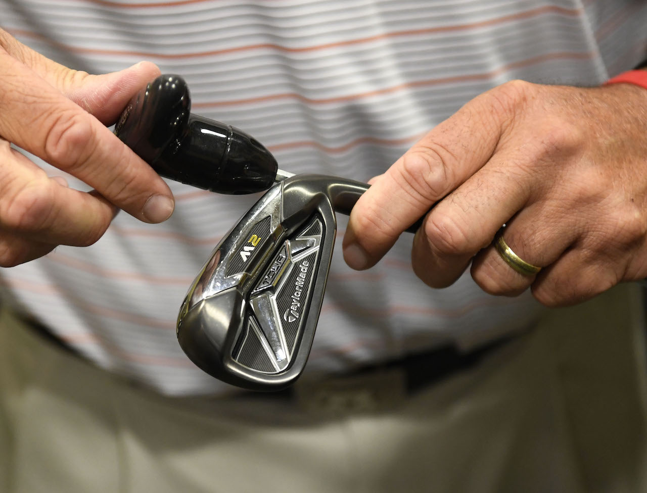 Golf club fitting with tool