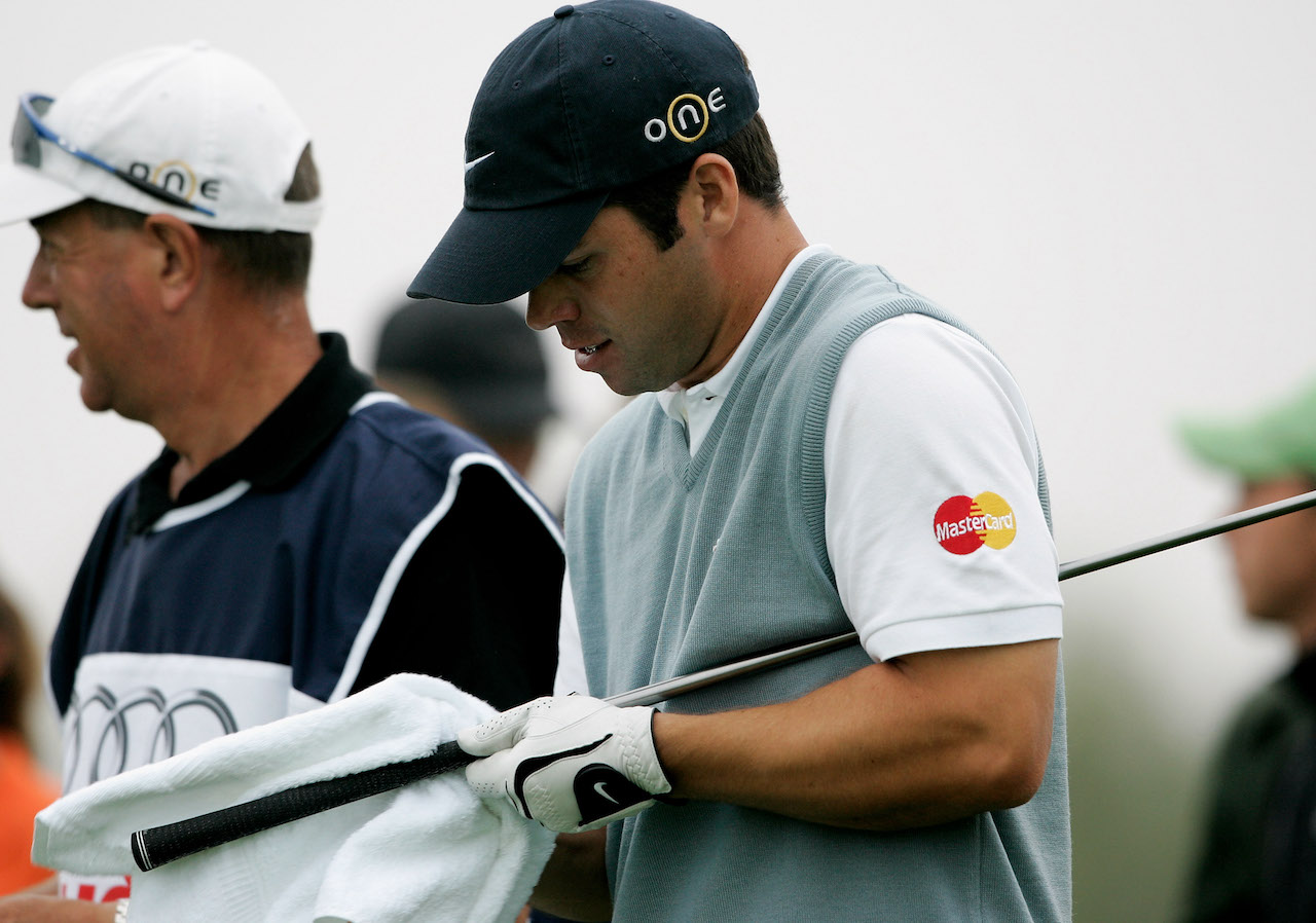 Pro golfer cleaning his golf grip