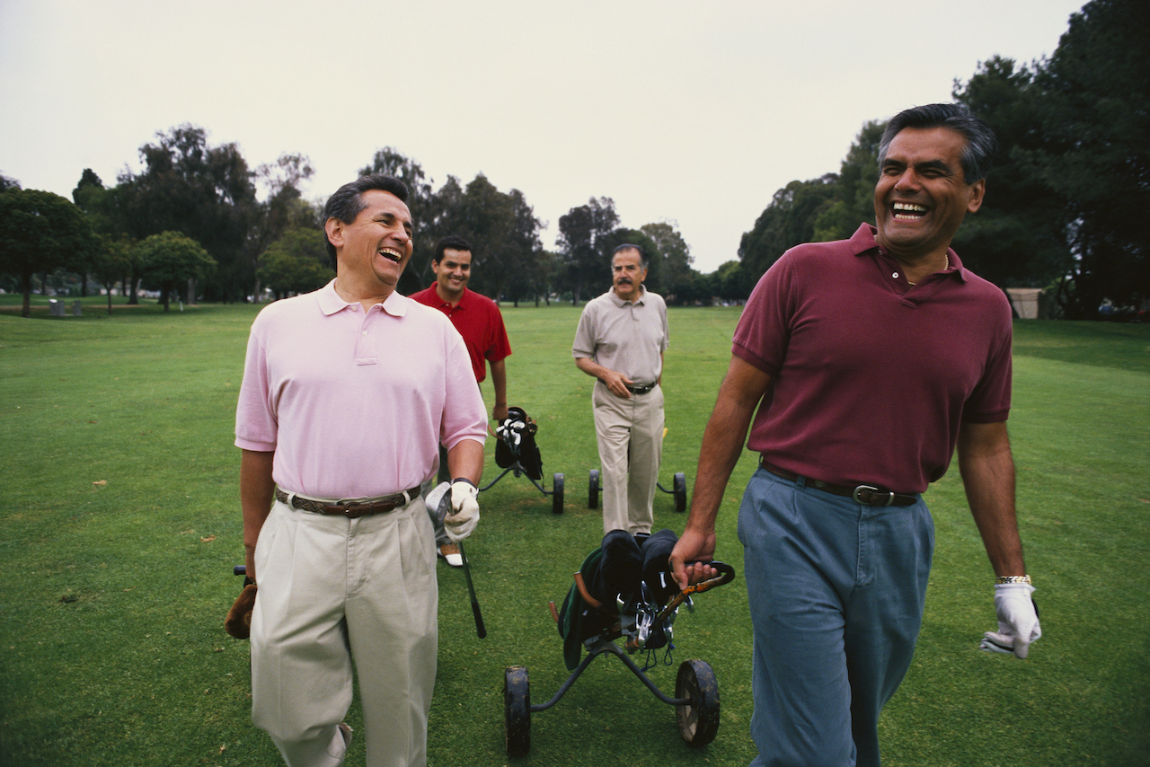 group of golfers walking on course