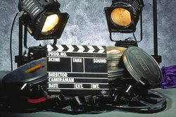 movie clap board with reels
