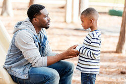 Father talking with his son