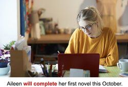 Female student writing at home