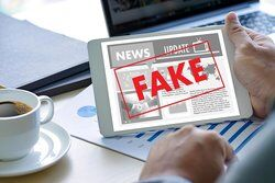 Fake news on a digital tablet