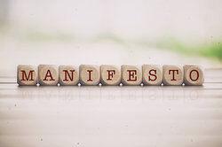 Manifesto word written on cube wooden blocks