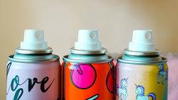 three aerosol cans