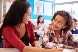 Teacher talking with student