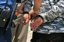 Image of a man being arrested
