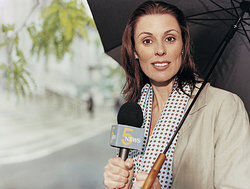 News Reporter With a Microphone As Tips on Writing a News Report